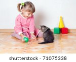 Stock photo the girl plays with a kitten an interior 71075338
