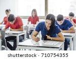 group of high school students... | Shutterstock . vector #710754355