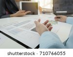 investor executive discussing... | Shutterstock . vector #710766055