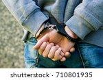 close up handcuffed hands of a... | Shutterstock . vector #710801935