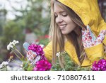 balcony with purple geranium  | Shutterstock . vector #710807611