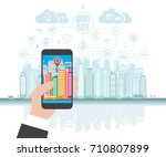 smartphone in hand helps to... | Shutterstock . vector #710807899