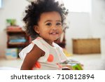 happy baby girl playing with... | Shutterstock . vector #710812894