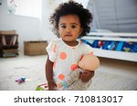 portrait of baby girl playing... | Shutterstock . vector #710813017