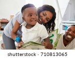 family with young children... | Shutterstock . vector #710813065