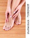 beautiful female feet and hands ... | Shutterstock . vector #710824639