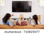 rear view of female friends... | Shutterstock . vector #710825077