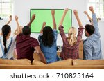 group of young friends watching ... | Shutterstock . vector #710825164
