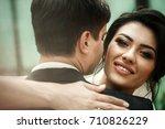 look from behind groom's... | Shutterstock . vector #710826229