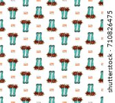 vector blue polka dot wellies... | Shutterstock .eps vector #710826475
