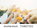 close view of friends cheering... | Shutterstock . vector #710827321