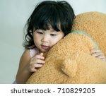 Little Girl Hugging Big Teddy...