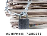 pile of newspapers with chains, on white - stock photo