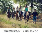 friends horseback riding in the ... | Shutterstock . vector #710841277