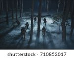 Special Forces soldiers in action. Elite squad moves through fog and smoke. They use special equipment, weapons and tactical devices. - stock photo