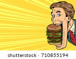hungry man with a giant burger... | Shutterstock .eps vector #710855194