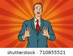 scared male businessman. pop... | Shutterstock .eps vector #710855521