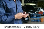 in a caretaker a mechanic uses... | Shutterstock . vector #710877379
