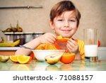 boy  breakfast  drinks milk ... | Shutterstock . vector #71088157