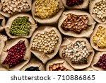 various of legumes in sack bag  ... | Shutterstock . vector #710886865