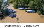 Small photo of Flood waters totally submerge homes and buildings as hurricane Harvey destroys everything along the Texas gulf coast August 30th 2017 drone view above houses