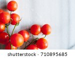 cherry tomatoes on marble... | Shutterstock . vector #710895685
