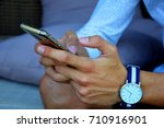 hands of young man writing... | Shutterstock . vector #710916901