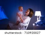 mother and baby reading a book...   Shutterstock . vector #710920027