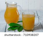 yellow juice in glass pitcher... | Shutterstock . vector #710938207