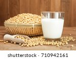 soy milk and soy bean on wooden ... | Shutterstock . vector #710942161