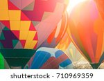 hot air balloons being inflated | Shutterstock . vector #710969359