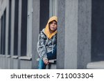 preteen boy on a street in a... | Shutterstock . vector #711003304