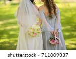bride with flowers and maids of ... | Shutterstock . vector #711009337