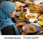 muslim girl having dinner at... | Shutterstock . vector #711011029