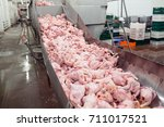 the meat factory. chicken on a... | Shutterstock . vector #711017521