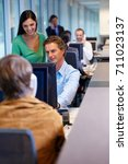 office workers looking at a... | Shutterstock . vector #711023137