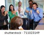 business team closing a deal | Shutterstock . vector #711023149