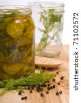 Freshly made pickles preserved with dill and peppercorns - stock photo