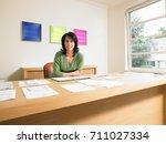 smiling businesswoman looking... | Shutterstock . vector #711027334