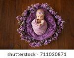 newborn baby sleeping in violet ... | Shutterstock . vector #711030871