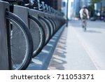 man riding his bike on a busy... | Shutterstock . vector #711053371