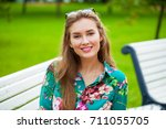 young happy brunette woman in... | Shutterstock . vector #711055705