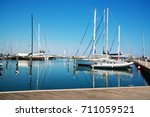 yachts in the port waiting. | Shutterstock . vector #711059521