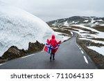bjorgavegen   snowy road in...   Shutterstock . vector #711064135