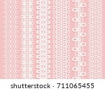 wide lace ribbons set on a pink ... | Shutterstock . vector #711065455