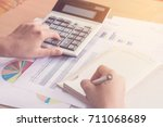 woman hand using calculator and ... | Shutterstock . vector #711068689