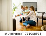 little boy playing toys with... | Shutterstock . vector #711068935
