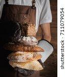 variety of freshly baked breads ... | Shutterstock . vector #711079054