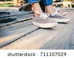 close up shoes on wood floor... | Shutterstock . vector #711107029