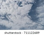 Small photo of Abstract clouds in blue sky can be used as a trendy background for wallpapers, posters, cards, invitations, websites, on a white paper. Best regard. AUM.